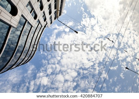 high-rise building and sky with clouds