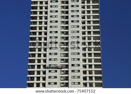 High-rise building and window cleaners - stock photo