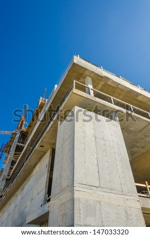High-rise building under construction against blue sky