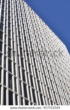 High rise building with many windows. - stock photo