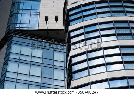 High rise building with window line pattern perspective.