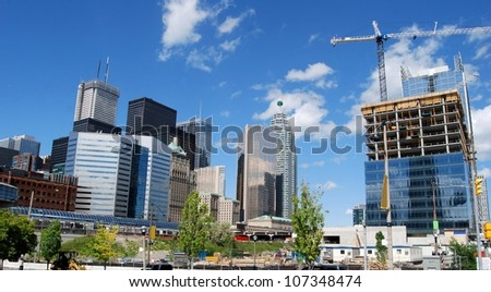 High Rise Buildings, and Construction Sites in Downtown Toronto, Canada - stock photo
