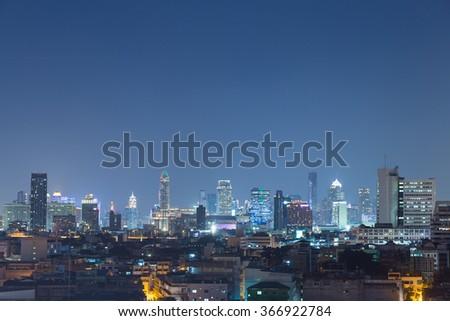 High-rise buildings in downtown Bangkok at night. Residential buildings and high-rise buildings in Bangkok at night with lights. - stock photo