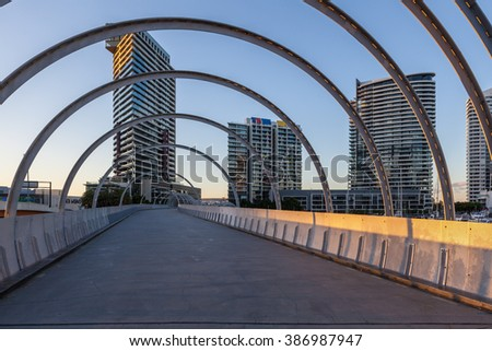 High rise buildings viewed through the arches of Webb bridge, Docklands, Melbourne.