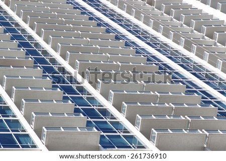 high rise condominium in white and blue.  - stock photo