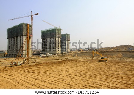high rise residential construction site in a city, north china - stock photo