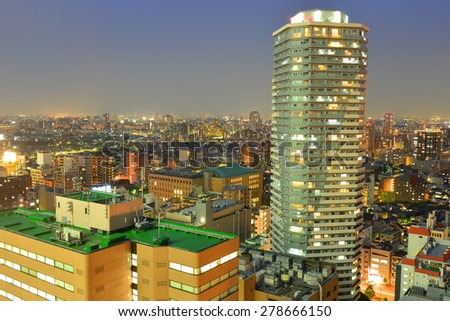 High-rising buildings lighting up during sunset in Tokyo, Japan - stock photo