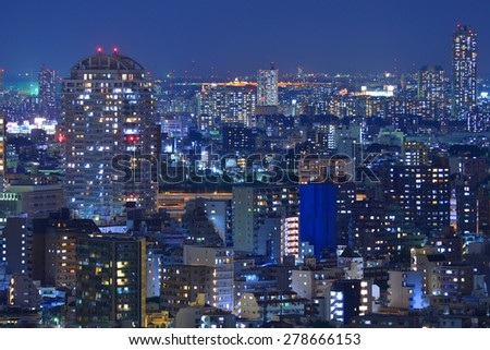 High-rising buildings lighting up during sunset in Tokyo, Japan