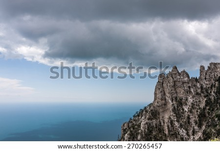 High rocks Ai-Petri of Crimean mountains. Black sea coast and blue sky with clouds