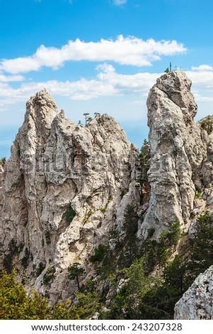 High rocks Ai-Petri of Crimean mountains. Black sea coast and blue sky with clouds. Russia - stock photo