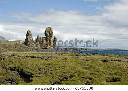 High rocks in the middle of lava field in West Iceland - stock photo
