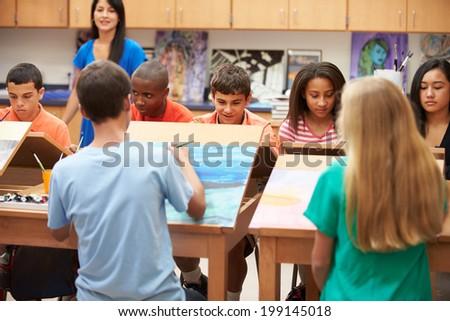 High School Art Class With Teacher - stock photo