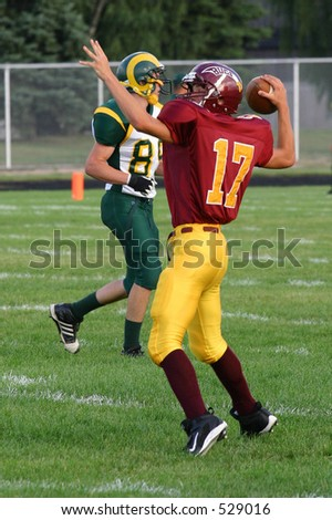 High School Football -Quaterback - stock photo
