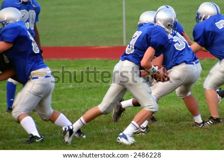 High school football team during a game. - stock photo