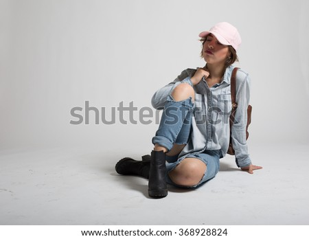 High School Girl Wearing Jeans and Leather Backpack