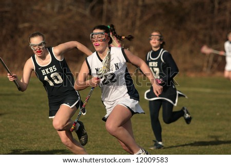 High School girls lacrosse. Editorial use - stock photo