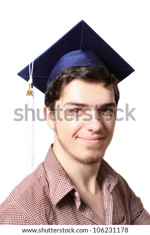 High school male graduate with blue cap smiling on a white background