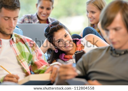 High-school pupils in study room music books smiling teens college - stock photo