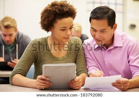 High School Student And Teacher Using Digital Tablet - stock photo