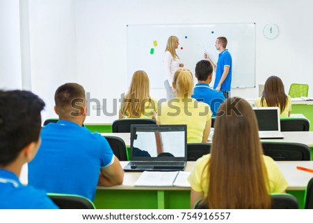 High school student answering next whit board