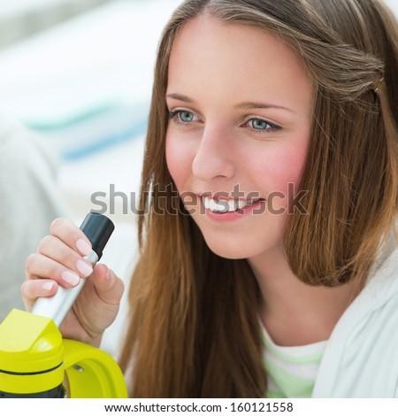 High School students. Beautiful girl working at biology classroom: using microscope - stock photo