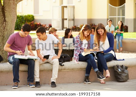 High School Students Hanging Out On Campus