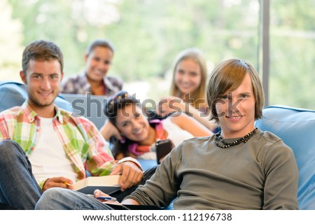 High-school students in study room reading writing teens college young - stock photo