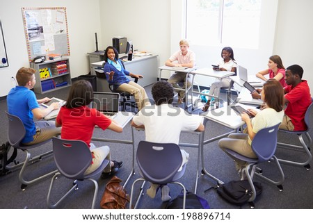 High School Students Taking Part In Group Discussion - stock photo