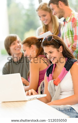 High-school study group learning in library class students teen smiling - stock photo