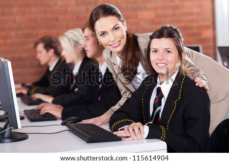 high school teacher and students in computer room - stock photo