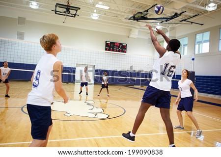 High School Volleyball Match In Gymnasium - stock photo