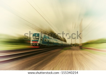 High-speed commuter train with motion blur, vintage - stock photo