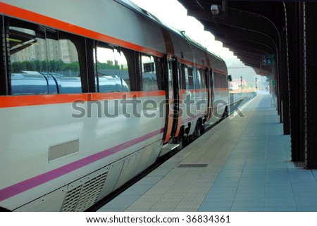 high-speed electric train on station platform in Santiago de Compostela, Spain, Galicia - stock photo