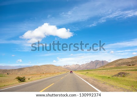 High-speed highway leading to a mountains range - stock photo