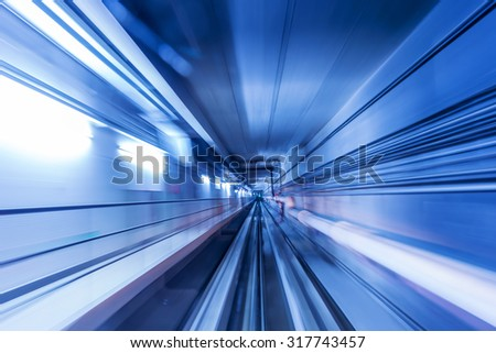 high speed movement in a tunnel in blue light