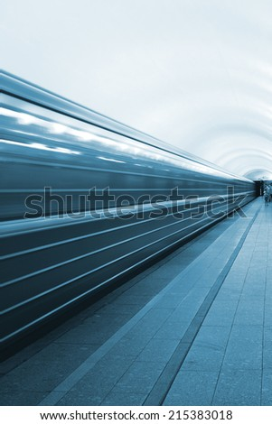High-speed movement of the train in the subway  - stock photo