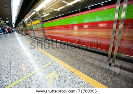 high speed moving train in subway station.