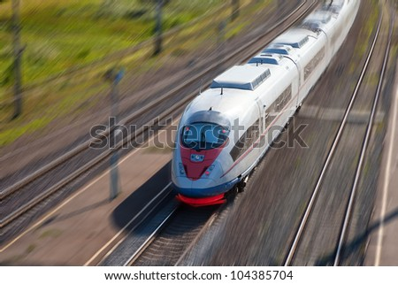 High-speed passenger train in motion - stock photo