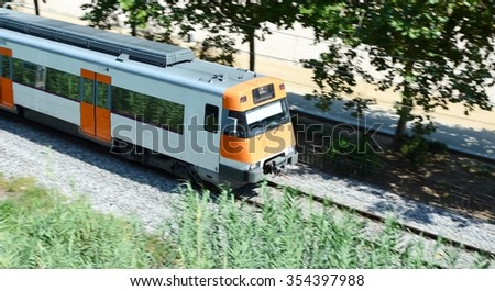 High speed passing passenger train. Blurred background. - stock photo