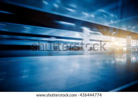 high-speed train at the railway station,motion blurred, china.