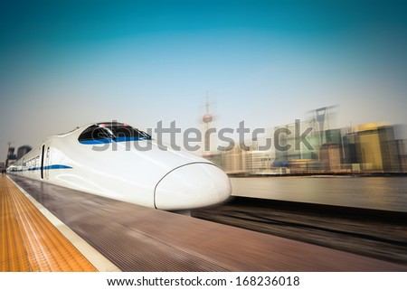 high speed train with motion blur background of the shanghai skyline  - stock photo