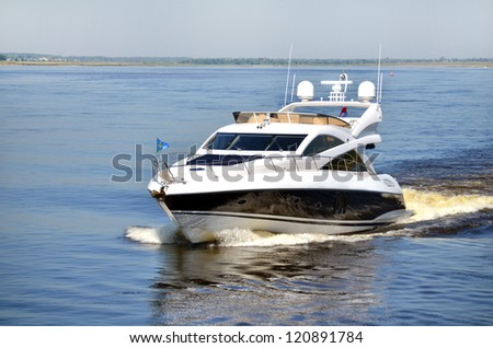 High speed white yacht on Volga river in Russia