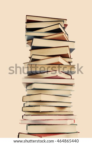 High stack of books on light background