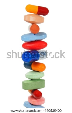 High stack of pills isolated on white background - stock photo
