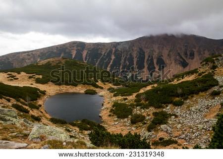 High Tatras autumn mountains lake reflexion - stock photo