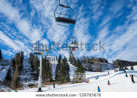 HIGH TATRAS, STRBSKE PLESO,SLOVAKIA - JANUARY 03, 2016: Winter mountains panorama with ski slopes and ski lifts