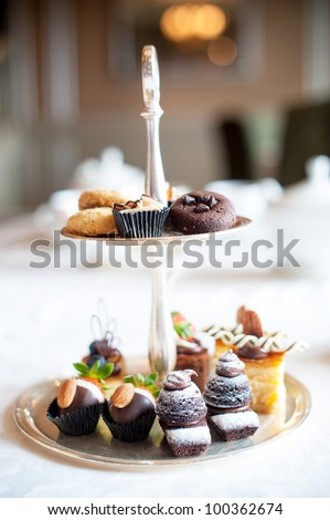High Tea sweet desserts on tray - stock photo