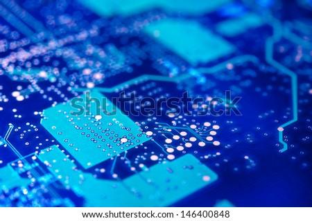 High-tech background. Electronic circuit board. Macro. Selective focus. - stock photo