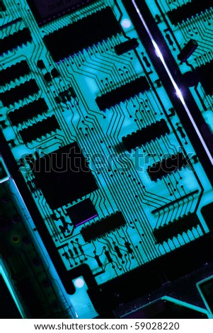 High tech computer circuit board with high impact resistors that has been back lit for a surreal electronic fantasy image.  Great for use as a blue background IT image