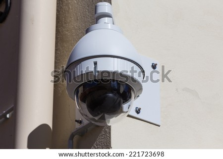 High tech overhead security camera at a government owned building - stock photo